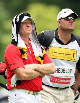 KUALA LUMPUR, MALAYSIA - MARCH 08:  Peter Hedblom of Sweden trys to keep cool during the third round of the Maybank Malaysian Open held at the Kota Permai Golf & Country Club on March 8, 2008 in Kuala Lumpur, Malaysia  (Photo by Ross Kinnaird/Getty Images)