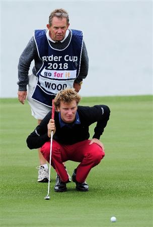 COLOGNE, GERMANY - SEPTEMBER 10:  Chris Wood of England and caddie Dave McNeilly line up a putt on the 18th hole during the first round of The Mercedes-Benz Championship at The Gut Larchenhof Golf Club on September 10, 2009 in Cologne, Germany.  (Photo by Stuart Franklin/Getty Images)