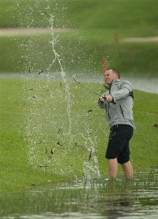 SINGAPORE - NOVEMBER 11:  Marcus Fraser of Australia plays from the water on the 3rd hole during the First Round of the Barclays Singapore Open at Sentosa Golf Club on November 11, 2010 in Singapore, Singapore.  (Photo by Ian Walton/Getty Images)
