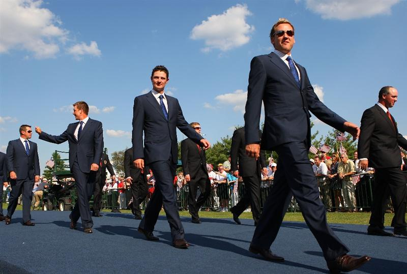 LOUISVILLE, KY - SEPTEMBER 18:  Ian Poulter (R) and Justin Rose (L) of the European team walk alongside their teammates and the USA team during the opening ceremony for the 2008 Ryder Cup at Valhalla Golf Club on September 18, 2008 in Louisville, Kentucky.  (Photo by Andrew Redington/Getty Images)