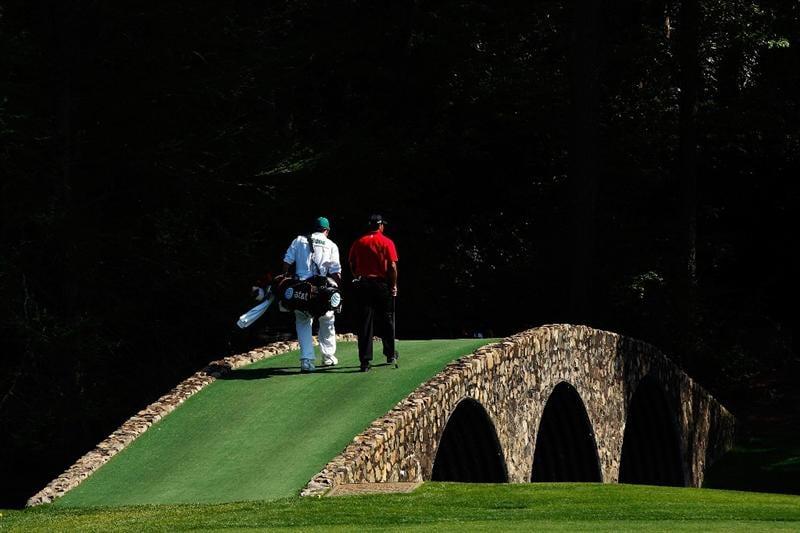 AUGUSTA, GA - APRIL 12:  Tiger Woods and his caddie Steve Williams cross Hogan's Bridge during the final round of the 2009 Masters Tournament at Augusta National Golf Club on April 12, 2009 in Augusta, Georgia.  (Photo by Jamie Squire/Getty Images)
