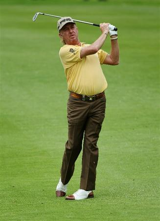 SUN CITY, SOUTH AFRICA - DECEMBER 03:  Miguel Angel Jimenez of Spain plays his second shot into the eighth green during the second round of the 2010 Nedbank Golf Challenge at the Gary Player Country Club Course  on December 3, 2010 in Sun City, South Africa.  (Photo by Warren Little/Getty Images)