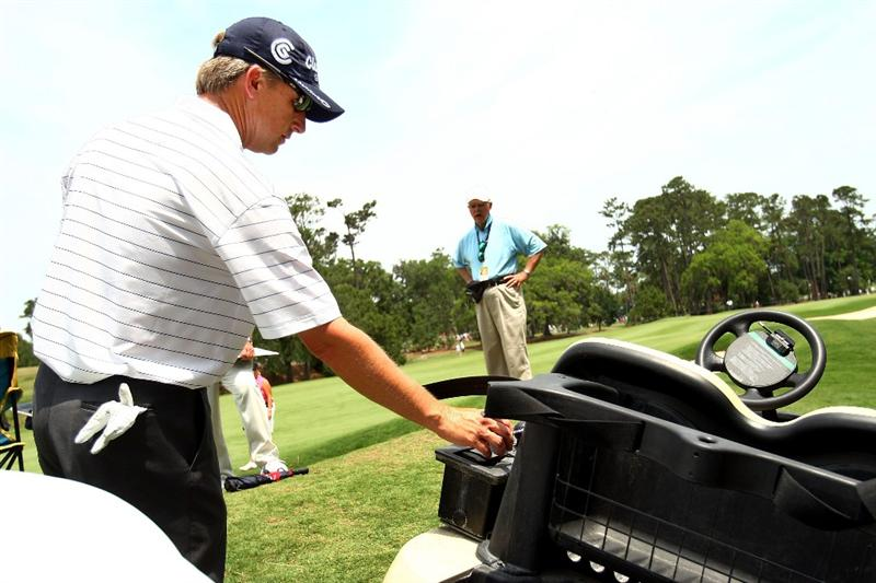 PONTE VEDRA BEACH, FL - MAY 07:  David Toms takes relief after his ball landed on a golf cart on the seventh hole during the first round of THE PLAYERS Championship on THE PLAYERS Stadium Course at TPC Sawgrass on May 7, 2009 in Ponte Vedra Beach, Florida.  (Photo by Scott Halleran/Getty Images)