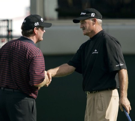 Bob Gilder, right, shakes hands with R.W. Eaks after the second round of the 2005 SAS Championship Saturday, Oct. 1, 2005, at Prestonwood Country Club in Cary, N.C.Photo by Grant Halverson/WireImage.com