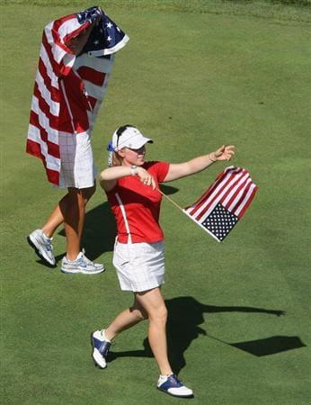SUGAR GROVE, IL - AUGUST 23: Angela Stanford and Morgan Pressel of the U.S. Team celebrate on the 18th fairway after the match was won in the Sunday singles matches at the 2009 Solheim Cup Matches at the Rich Harvest Farms Golf Club on August 23, 2009 in Sugar Grove, Ilinois (Photo by David Cannon/Getty Images)
