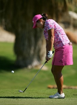 PALM DESERT, CA - OCTOBER 12:  Jee Young Lee of South Korea makes a chip shot on the second hole during the second round of the LPGA Samsung World Championship at the Bighorn Golf Club on October 12, 2007 in Palm Desert, California.  (Photo by Robert Laberge/Getty Images)
