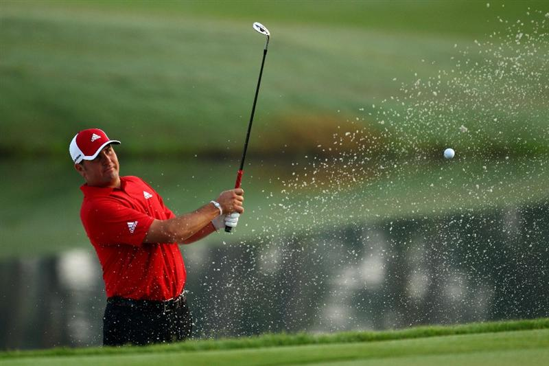 PONTE VEDRA BEACH, FL - MAY 04:  Pat Perez plays a shot from a bunker during a practice round prior to the start of THE PLAYERS Championship held at THE PLAYERS Stadium course at TPC Sawgrass on May 4, 2010 in Ponte Vedra Beach, Florida.  (Photo by Richard Heathcote/Getty Images)