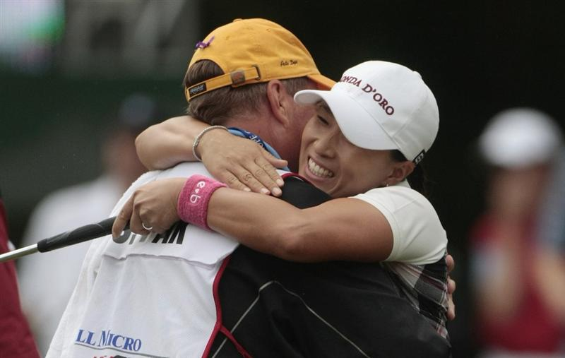 MOBILE, AL - MAY 16: Se Ri Pak of South Korea hugs her caddie in the Bell Micro LPGA Classic at the Magnolia Grove Golf Course on May 16, 2010 in Mobile, Alabama. Pak beat Suzann Pettersen and Brittany Lincicome in the playoff after the tournament was shortened to 54-holes because of rain. (Photo by Dave Martin/Getty Images)