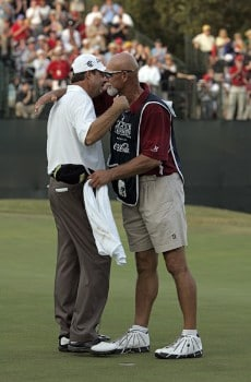 Bart Bryant hugs his caddie after sinking a putt on the 18th green during the final round to win THE TOUR Championship at East Lake Golf Club in Atlanta, Georgia on November 6, 2005.Photo by Sam Greenwood/WireImage.com