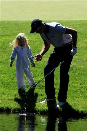 AUGUSTA, GA - APRIL 06:  Lisa Stenson waits near a green with her father Henrik during the Par 3 Contest prior to the 2011 Masters Tournament at Augusta National Golf Club on April 6, 2011 in Augusta, Georgia.  (Photo by David Cannon/Getty Images)