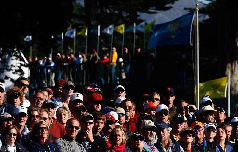 SAN FRANCISCO - OCTOBER 09:  Golf fans watch the play on the 14th hole during the Day Two Fourball Matches of The Presidents Cup at Harding Park Golf Course on October 9, 2009 in San Francisco, California.  (Photo by Scott Halleran/Getty Images)