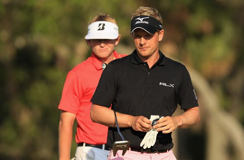 HILTON HEAD ISLAND, SC - APRIL 24:  Luke Donald of England walks on the 17th greeen with Brandt Snedeker in a playoff during the final round of The Heritage at Harbour Town Golf Links on April 24, 2011 in Hilton Head Island, South Carolina.  (Photo by Streeter Lecka/Getty Images)