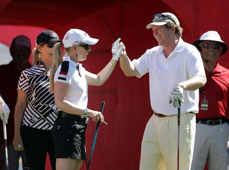 RANCHO MIRAGE, CA - MARCH 30:  Morgan Pressel of the USA congratulates on of her playing partners on his 1st tee tee shot on the 1st tee during the pro-am for the 2011 Kraft Nabisco Championship on the Dinah Shore Championship Course at the Mission Hills Country Club on March 30, 2011 in Rancho Mirage, California.  (Photo by David Cannon/Getty Images)