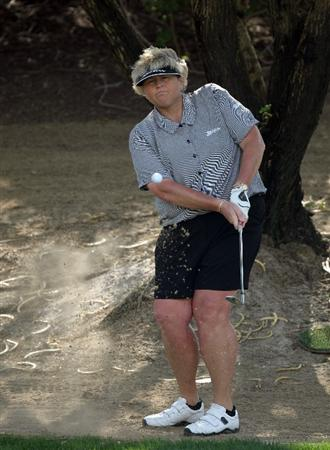 DUBAI, UNITED ARAB EMIRATES - DECEMBER 12: Laura Davies of England plays her third shot at the 3rd hole during the second round of the Dubai Ladies Masters on the Majilis Course at the Emirates Golf Club on December 12, 2008 in Dubai,United Arab Emirates  (Photo by David Cannon/Getty Images)