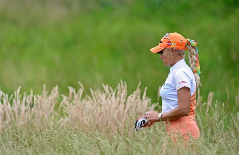HAVRE DE GRACE, MD - JUNE 11: Natalie Gulbis walks to the fifth tee during the first round of the McDonald's LPGA Championship at Bulle Rock Golf Course on June 11, 2009 in Havre de Grace, Maryland. (Photo by Drew Hallowell/Getty Images)
