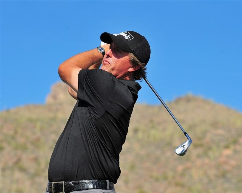 MARANA, AZ - FEBRUARY 24:  Phil Mickelson plays a tee shot during practice prior to the start of Accenture Match Play Championships at The Ritz-Carlton Golf Club at Dove Mountain February 24, 2009 in Marana, Arizona.  (Photo by Stuart Franklin/Getty Images)