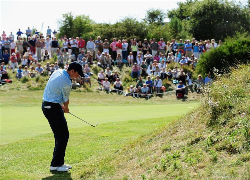 ZANDVOORT, NETHERLANDS - AUGUST 22:  Peter Lawrie of Ireland plays his approach shot on the seventh hole during the third round of The KLM Open at Kennemer Golf & Country Club on August 22, 2009 in Zandvoort, Netherlands.  (Photo by Stuart Franklin/Getty Images)