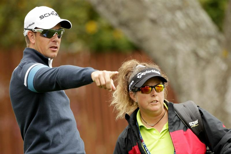 PEBBLE BEACH, CA - JUNE 15:  Henrik Stenson of Sweden discusses a shot with caddie Fannie Suneson during a practice round prior to the start of the 110th U.S. Open at Pebble Beach Golf Links on June 15, 2010 in Pebble Beach, California.  (Photo by Andrew Redington/Getty Images)