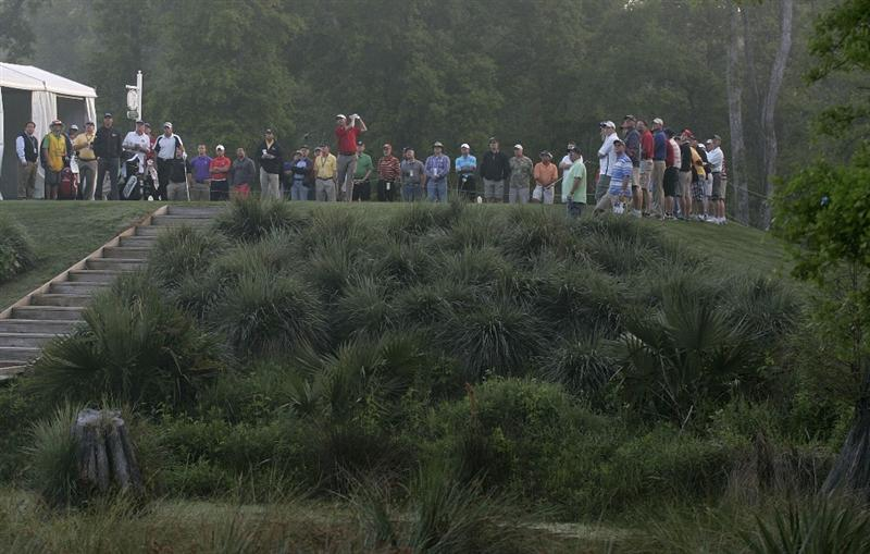 HUMBLE, TX - APRIL 01:  Players hit their drives on the 10th tee box after a fog delays the second round of the Shell Houston Open at Redstone Golf Club on April 1, 2011 in Humble, Texas.  (Photo by Michael Cohen/Getty Images)