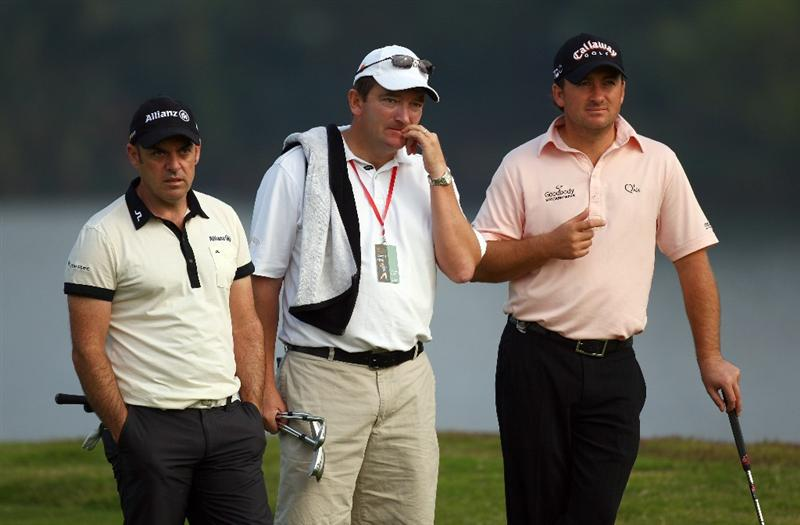 SHENZHEN, CHINA - NOVEMBER 26:  Paul McGinley and Graeme McDowell of Ireland look on during the Pro - Am of the Omega Mission Hills World Cup at the Mission Hills Resort on November 26, 2008 in Shenzhen, China.  (Photo by Ian Walton/Getty Images)