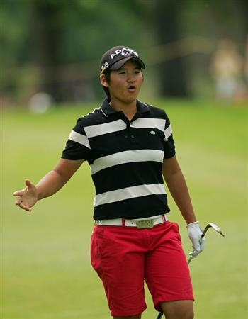 CORNING, NY - MAY 23:  Yani Tseng of Taiwan reacts after nearly holing her second shot on the 18th hole during the third round of the LPGA Corning Classic at the Corning Country Club held on May 23, 2009 in Corning, New York.  (Photo by Michael Cohen/Getty Images)