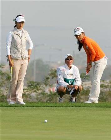 INCHEON, SOUTH KOREA - OCTOBER 30:  Hee-Young-Park of South Korea and Kyeong Bae of South Korea in the 12th hole during round one of Hana Bank Kolon Championship at Sky 72 Golf Club on October 30, 2009 in Incheon, South Korea.  (Photo by Chung Sung-Jun/Getty Images)