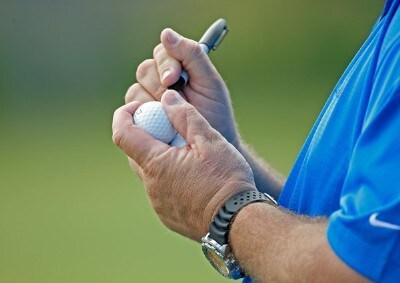 Jim Thorpe's caddie Tony Shepherd marks golf balls prior to the final round of the MasterCard Championship at Hualalai held on January 20, 2008 at Hualalai Golf Club in Ka'upulehu-Kona, Hawaii. Champions Tour - 2008 MasterCard Championship at Hualalai - Final RoundPhoto by Chris Condon/PGA TOUR/Getty Images