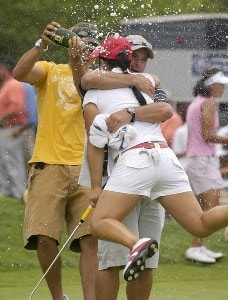 Jeong Jang celebrates with caddie Les Luark while being doused with champagne after winning the Wegmans LPGA with a 13-under 275 at Locust Hill Country Club in Rochester, New York on Sunday, June 25, 2006.Photo by Kevin Rivoli/WireImage.com