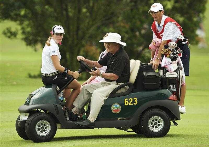 SINGAPORE - MARCH 07:  Paula Creamer of the USA makes her way back to the club house during a storm break in the third round of HSBC Women's Champions at the Tanah Merah Country Club on March 7, 2009 in Singapore.  (Photo by Victor Fraile/Getty Images)