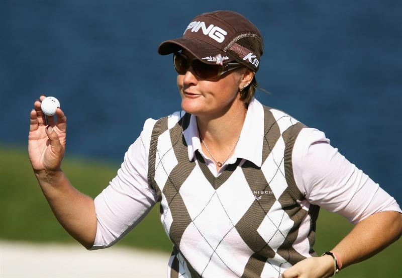 ORLANDO, FL - DECEMBER 05:  Maria Hjorth of Sweden waves to the gallery on the third green during the final round of the LPGA Tour Championship at the Grand Cypress Resort on December 5, 2010 in Orlando, Florida.  (Photo by Scott Halleran/Getty Images)