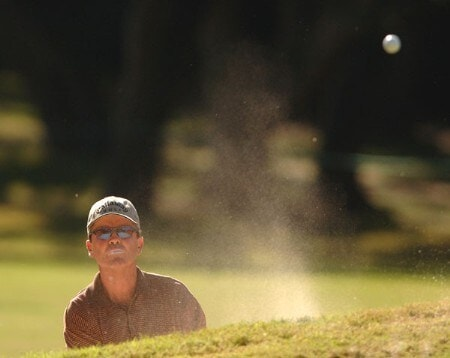 Mark McNulty hits from a14th greenside bunker during the second round of the Champion's TOUR 2005 SBC Championship at Oak Hills Country Club in San Antonio, Texas October 22, 2005.Photo by Steve Grayson/WireImage.com
