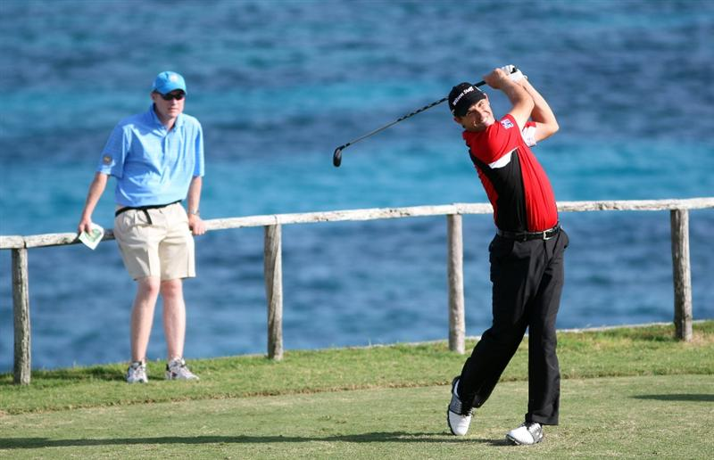 ST GEORGE, BERMUDA - OCTOBER 13:  Padraig Harrington of Ireland  tees off on the par four 4th hole watched by his caddie Ronan Flood during the pro am event prior to the PGA Grand Slam of Golf at the Mid Ocean Club on October 13, 2008 in St. George, Bermuda.  (Photo by Ross Kinnaird/Getty Images)