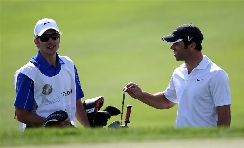 DOHA, QATAR - FEBRUARY 02:  Paul Casey of England and his caddie Christian Donald during the pro-am event prior to the Commercialbank Qatar Masters on February 2, 2011 in Doha, Qatar.  (Photo by Ross Kinnaird/Getty Images)