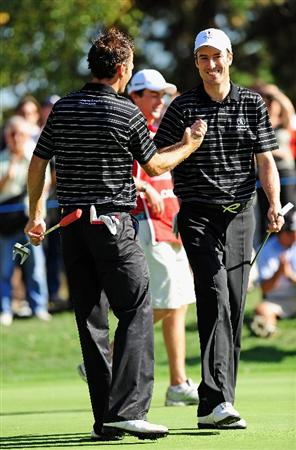 PARIS - SEPTEMBER 25:  Nick Dougherty and Ross Fisher of the Great Britian and Northern Ireland team celebrate their win on the 16th hole, during the second day fourball at The Vivendi Trophy with Severiano Ballesteros at Saint - Nom - La Breteche golf course on September 25, 2009 in Paris, France.  (Photo by Stuart Franklin/Getty Images)