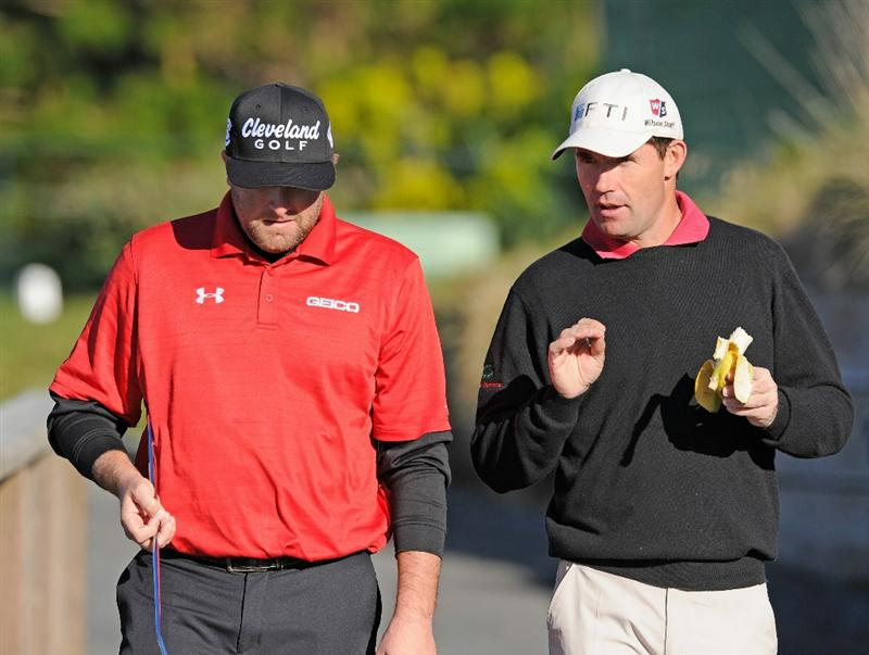 PEBBLE BEACH, CA - FEBRUARY 11:  Steve Marino talks with Padraig Harrington of Ireland during the second round of the AT&T Pebble Beach National Pro-Am at the Pebble Beach Golf Links on February 11, 2011  in Pebble Beach, California  (Photo by Stuart Franklin/Getty Images)