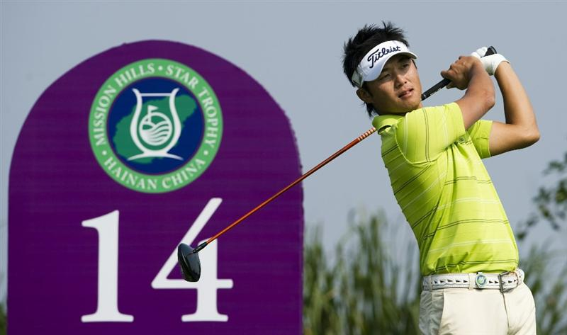 HAIKOU, CHINA - OCTOBER 30:  Ryuji Imada of Japan tees off on the 14th hole during day four of the Mission Hills Start Trophy tournament at Mission Hills Resort on October 30, 2010 in Haikou, China. The Mission Hills Star Trophy is Asia's leading leisure liflestyle event and features Hollywood celebrities and international golf stars.  (Photo by Victor Fraile/Getty Images for Mission Hills)