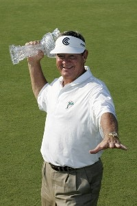 Bobby Wadkins holds the winner's trophy after the fourth and final round of the Ford Senior Players Championship held at TPC Michigan in Dearborn, Michigan, on July 16, 2006.Photo by: Stan Badz/PGA TOUR