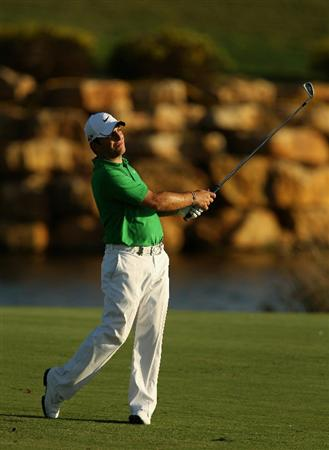 VILAMOURA, PORTUGAL - OCTOBER 14:  Francesco Molinari of Italy plays into the 18th green during the first round of the Portugal Masters at the Oceanico Victoria Golf Course on October 14, 2010 in Vilamoura, Portugal.  (Photo by Richard Heathcote/Getty Images)