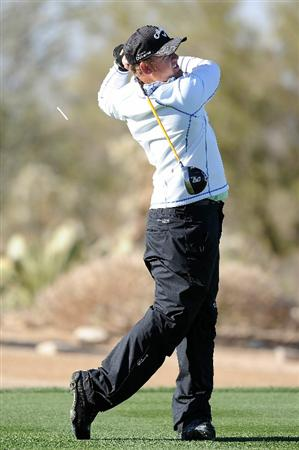MARANA, AZ - FEBRUARY 23:  J.B. Holmes hits a shot on the third hole during the first round of the Accenture Match Play Championship at the Ritz-Carlton Golf Club on February 23, 2011 in Marana, Arizona.  (Photo by Stuart Franklin/Getty Images)