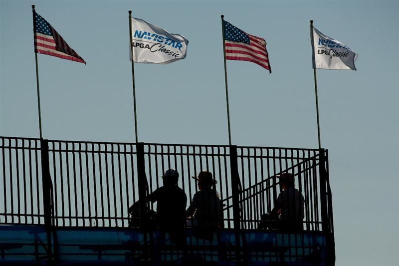 PRATTVILLE, AL - OCTOBER 7: Flags fly over the gradnstand at the 16th green during the first round of the Navistar LPGA Classic at the Senator Course at the Robert Trent Jones Golf Trail at Capitol Hill on October 7, 2010 in Prattville, Alabama. (Photo by Darren Carroll/Getty Images)