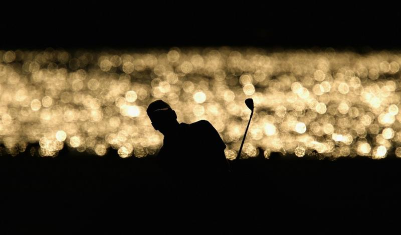 VILAMOURA, PORTUGAL - OCTOBER 16:  Robert Karlsson of Sweden pitches into the 14th green during the third round of the Portugal Masters at the Oceanico Victoria Golf Course on October 16, 2010 in Vilamoura, Portugal.  (Photo by Richard Heathcote/Getty Images)