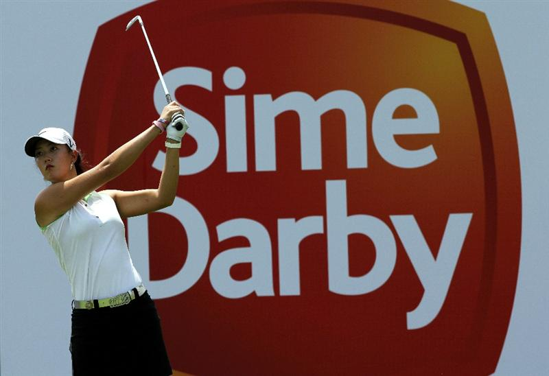 KUALA LUMPUR, MALAYSIA - OCTOBER 22 : Michelle Wie of the USA tees off on the 10th hole during Round One of the Sime Darby LPGA on October 22, 2010 at the Kuala Lumpur Golf and Country Club in Kuala Lumpur, Malaysia. (Photo by Stanley Chou/Getty Images)