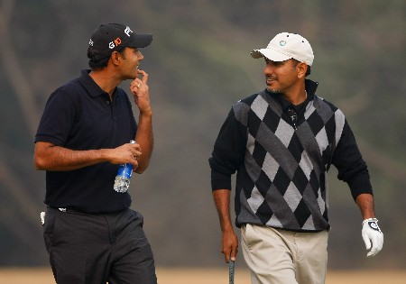 DELHI, INDIA - FEBRUARY 05:  Arjun Atwal and Jeev Milkha Singh of India during practice round of The EMAAR - MGF Indian Masters at Delhi golf Club on February 05, 2008 in Delhi, India.  (Photo by Stuart Franklin/Getty Images)