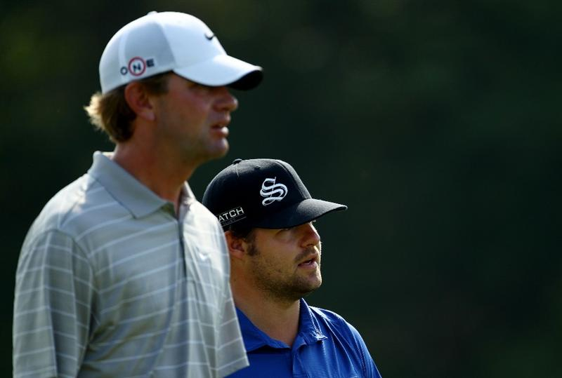 PONTE VEDRA BEACH, FL - MAY 07:  (L-R) Lucas Glover and Ryan Moore walk down the 14th fairway during the second round of THE PLAYERS Championship held at THE PLAYERS Stadium course at TPC Sawgrass on May 7, 2010 in Ponte Vedra Beach, Florida.  (Photo by Richard Heathcote/Getty Images)