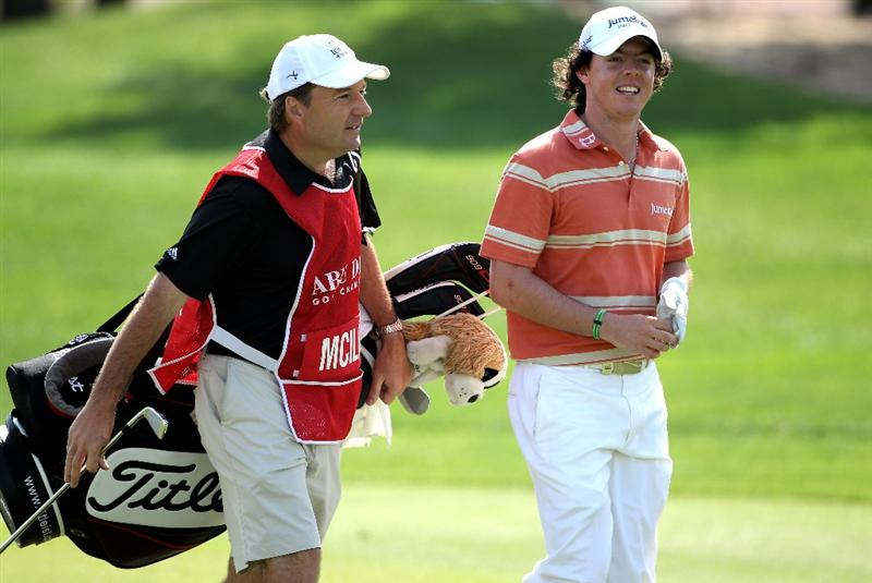 ABU DHABI, UNITED ARAB EMIRATES - JANUARY 23:  Rory McIlroy of Northern Ireland shares a joke with his caddie JP Fitzgerald on the fifth hole during the third round of The Abu Dhabi Golf Championship at Abu Dhabi Golf Club on January 23, 2010 in Abu Dhabi, United Arab Emirates.  (Photo by Andrew Redington/Getty Images)
