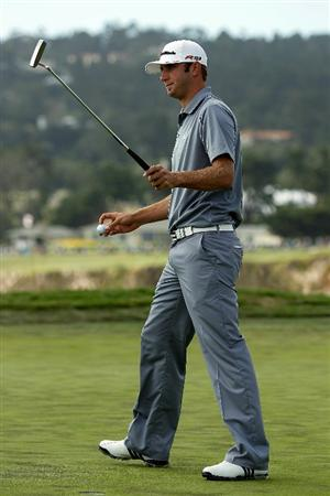 PEBBLE BEACH, CA - JUNE 19:  Dustin Johnson celebrates a birdie putt on the sixth hole during the third round of the 110th U.S. Open at Pebble Beach Golf Links on June 19, 2010 in Pebble Beach, California.  (Photo by Donald Miralle/Getty Images)