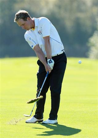 NEWPORT, WALES - OCTOBER 04:  Luke Donald of Europe hits an approach shot on the 11th hole in the singles matches during the 2010 Ryder Cup at the Celtic Manor Resort on October 4, 2010 in Newport, Wales.  (Photo by Andrew Redington/Getty Images)