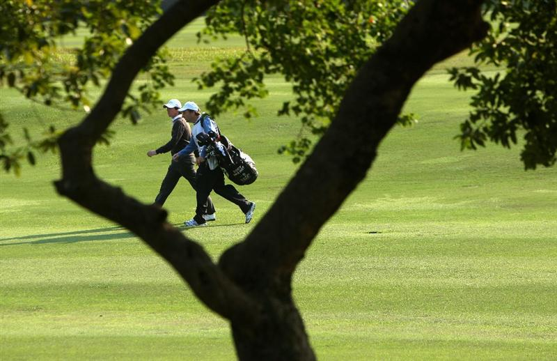 HONG KONG, CHINA - NOVEMBER 20:  Rory McIlroy of Northern Ireland and caddie J. P Fitzgerald walk down the fairway during the first round of the UBS Hong Kong Open at the Hong Kong Golf Club on November 20, 2008 in Fanling, Hong Kong.  (Photo by Stuart Franklin/Getty Images)