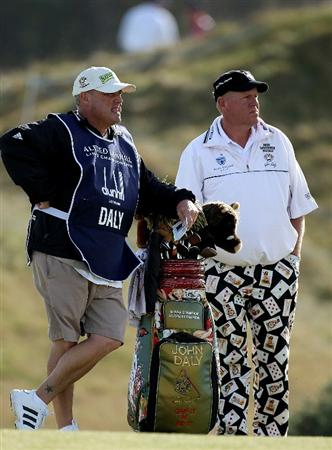 KINGSBARNS, SCOTLAND - OCTOBER 07:  John Daly of the USA with his caddie on the nineth hole during the first round of The Alfred Dunhill Links Championship at Kingsbarns Golf Links on October 7, 2010 in Kingsbarns, Scotland.  (Photo by Ross Kinnaird/Getty Images)