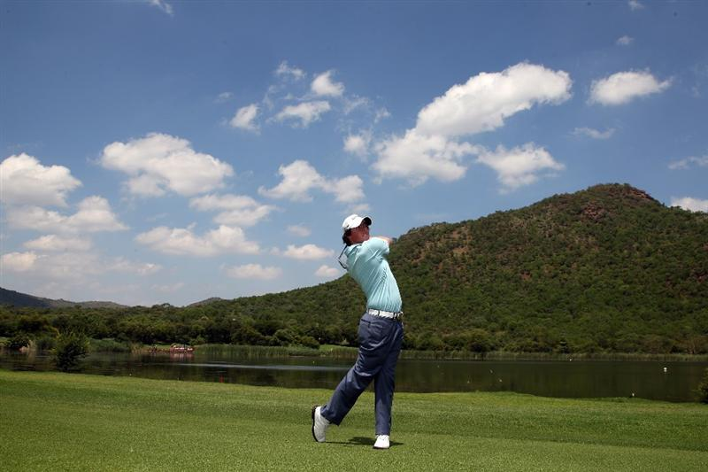 SUN CITY, SOUTH AFRICA - DECEMBER 02:  Rory McIlroy of Northern Ireland plays his second shot at the 17th hole during the pro-am as a preview for the 2009 Nedbank Golf Challenge at the Gary Player Country Club Course on December 2, 2009 in Sun City, South Africa.  (Photo by David Cannon/Getty Images)